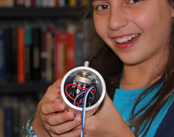 Abigail Prutchi holding partially-completed high-power UV/IR/visible LED flashlight. www.prutchi.com